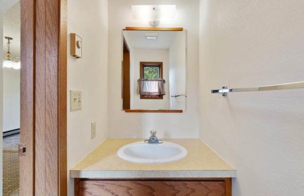 321 Perkins Place, Unit C, half bathroom off of kitchen