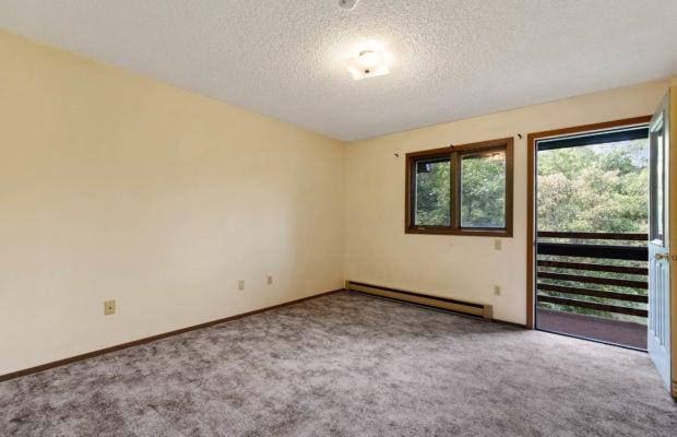 321 Perkins Place, Unit C, bedroom with door leading to outdoor balcony