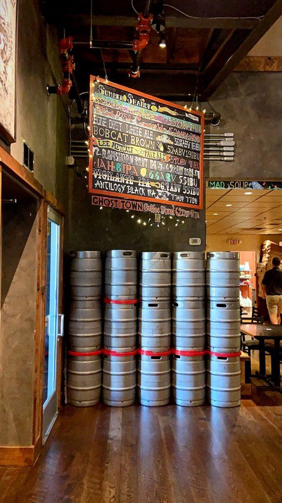 Menu and kegs inside of Bridger Brewing