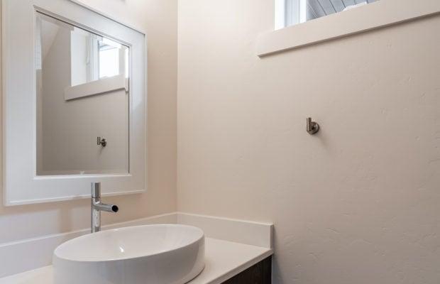 2440 Atsina Lane half bath below stairs on main floor