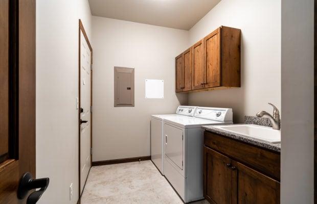 4275 Palisade Drive laundry room/mudroom between garage and hallway